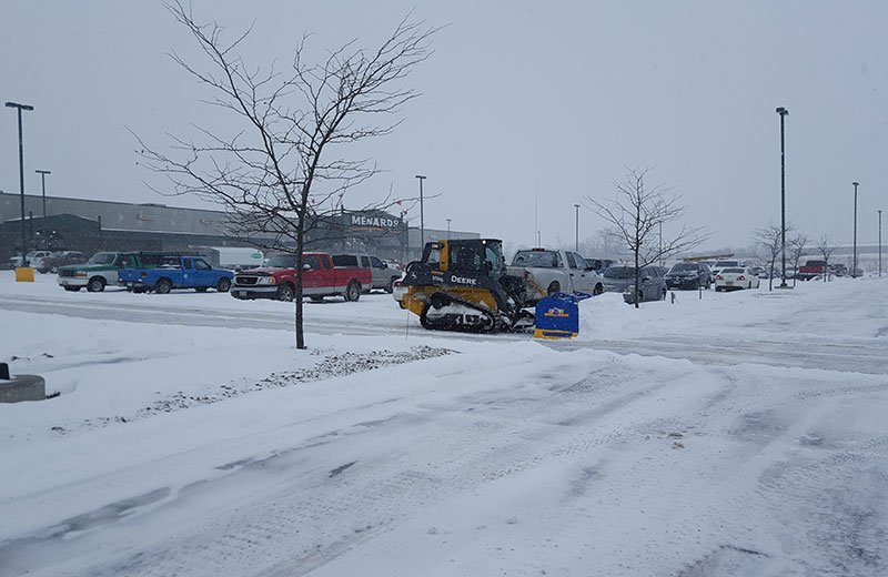 Snow removal in business parking lot